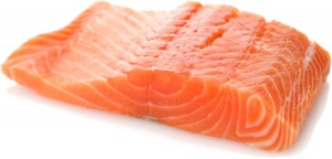 Raw Salmon Fillet On White Background , Close Up